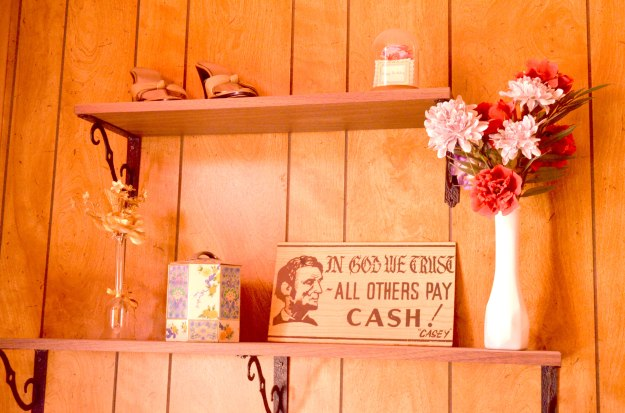 """In God We Trust, All Others Pay Cash -- Casey"" sign (Photo by Heather Branstetter, with thanks to Eva Truean and the Bordello Museum)"
